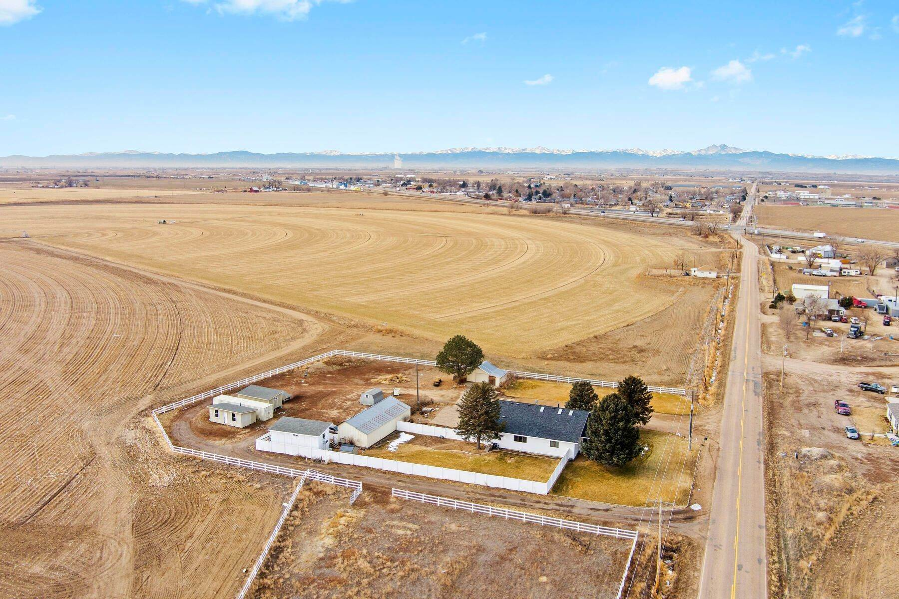 34. Single Family Homes for Active at Colorado Farmhouse of Your Dreams Nestled on Just Over Two Acres 15614 County Road 42 La Salle, Colorado 80645 United States