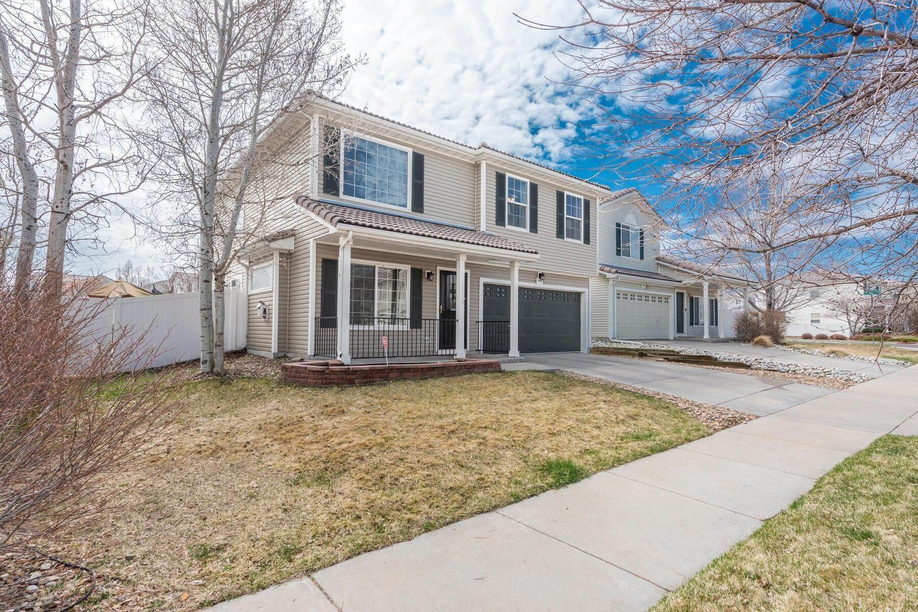 Single Family Homes for Active at Gorgeous & Extremely Well Maintained Green Valley Home! 4982 Fundy Street Denver, Colorado 80249 United States