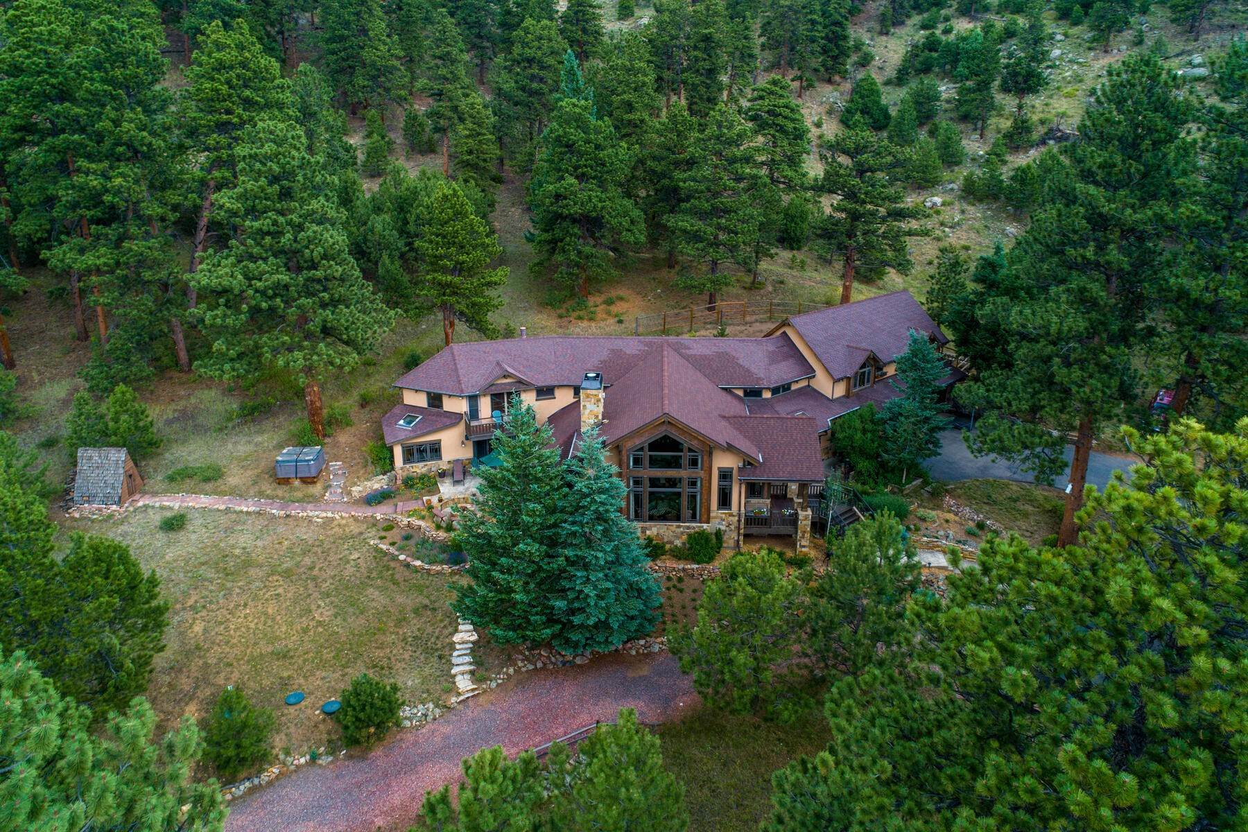 47. Single Family Homes for Active at Luxury Mountain Home with Endless Mountain Views & Ample Outdoor Living Spaces 34814 West Meadow Road Evergreen, Colorado 80439 United States