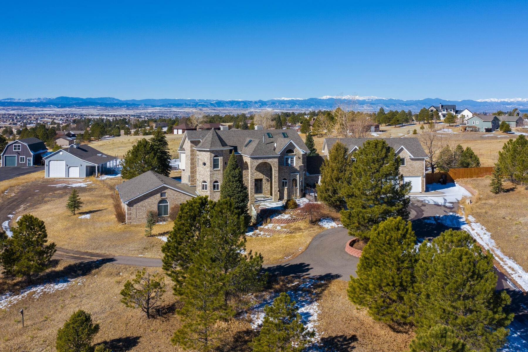 Single Family Homes for Active at Custom Brick Home With Extraordinary Mountain Views! 10897 E Pinewood Drive Parker, Colorado 80138 United States