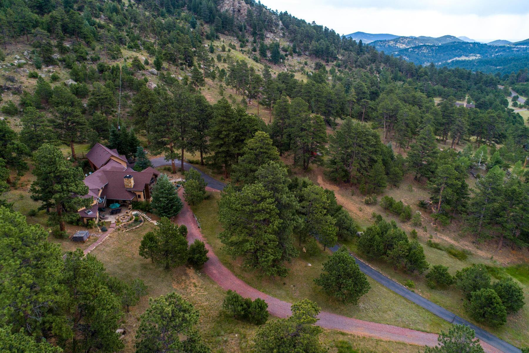 46. Single Family Homes for Active at Luxury Mountain Home with Endless Mountain Views & Ample Outdoor Living Spaces 34814 West Meadow Road Evergreen, Colorado 80439 United States