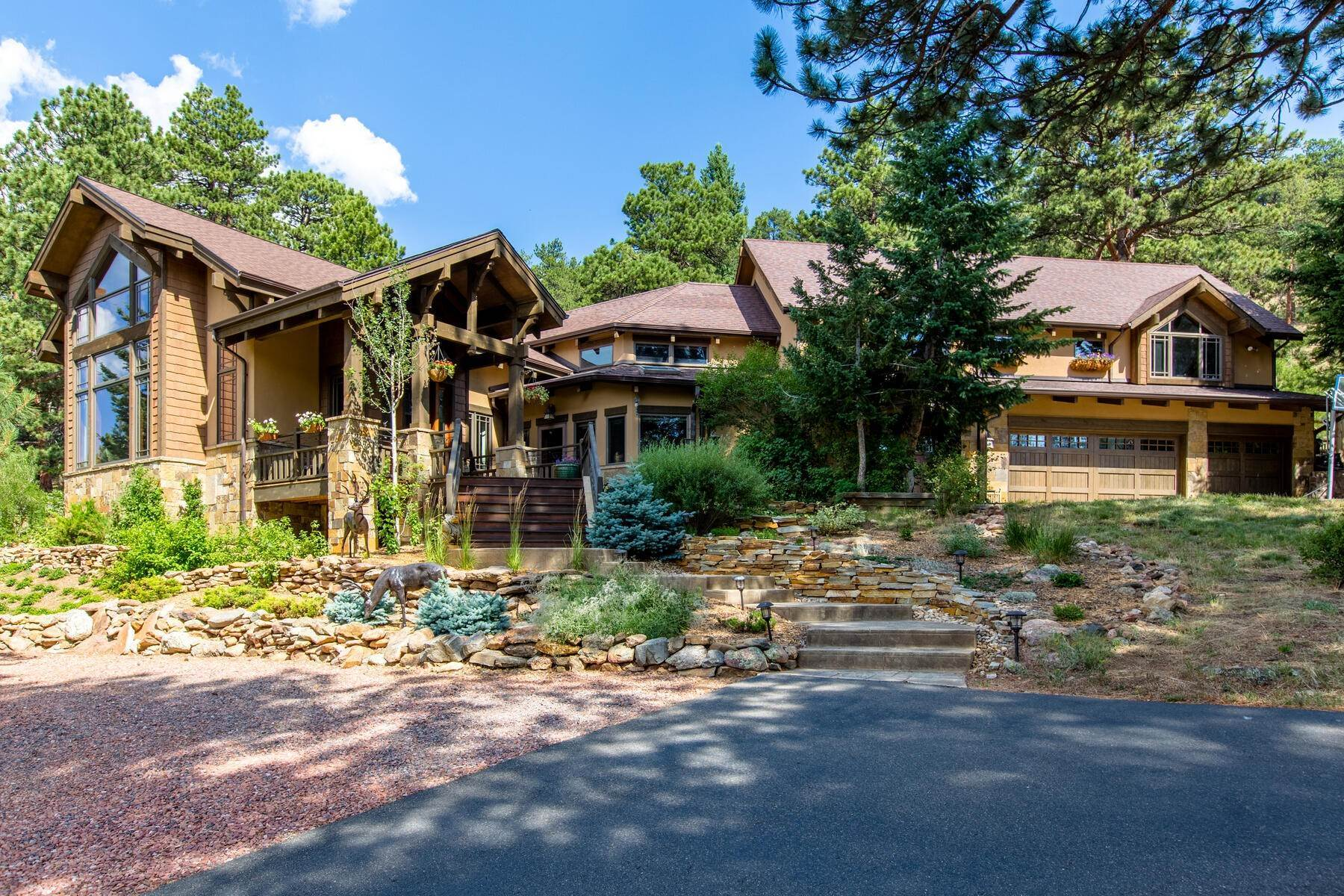 Single Family Homes for Active at Luxury Mountain Home with Endless Mountain Views & Ample Outdoor Living Spaces 34814 West Meadow Road Evergreen, Colorado 80439 United States