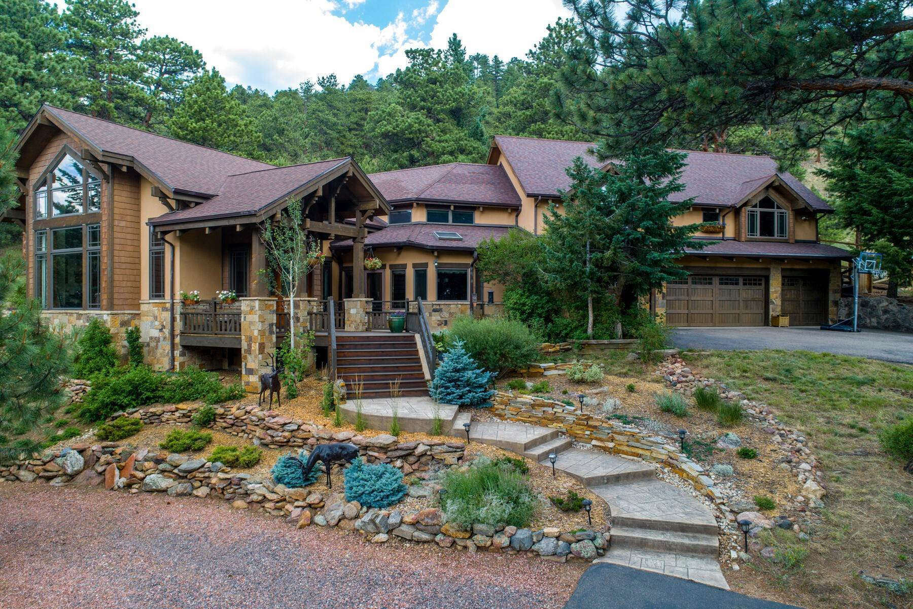 50. Single Family Homes for Active at Luxury Mountain Home with Endless Mountain Views & Ample Outdoor Living Spaces 34814 West Meadow Road Evergreen, Colorado 80439 United States
