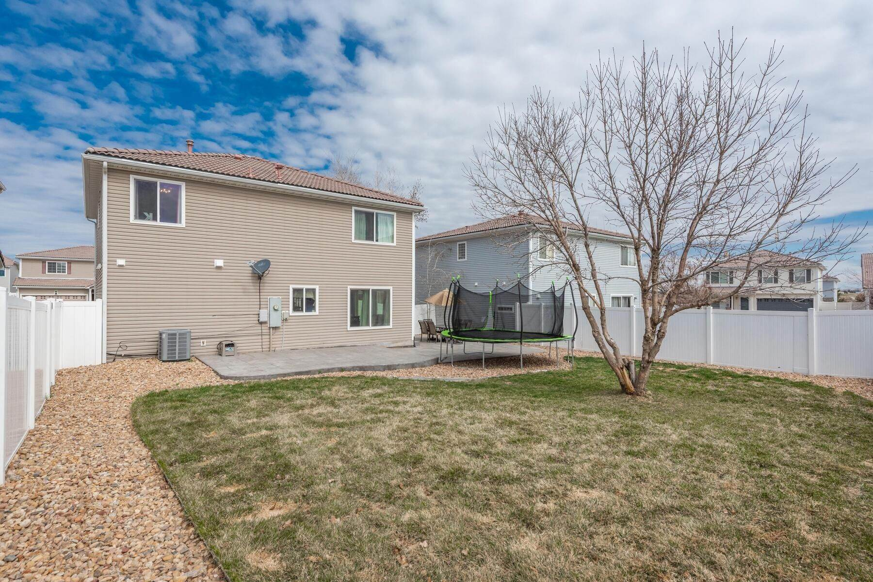 32. Single Family Homes for Active at Gorgeous & Extremely Well Maintained Green Valley Home! 4982 Fundy Street Denver, Colorado 80249 United States